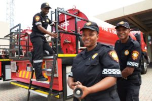 Ready to fight fire with their new Isuzu FXZ 26-360 6x4 fire-engine are, from left, Nelson Mandela Bay fire fighters Vuyo Marele, Doreen Jim and Mteza Mqopi.