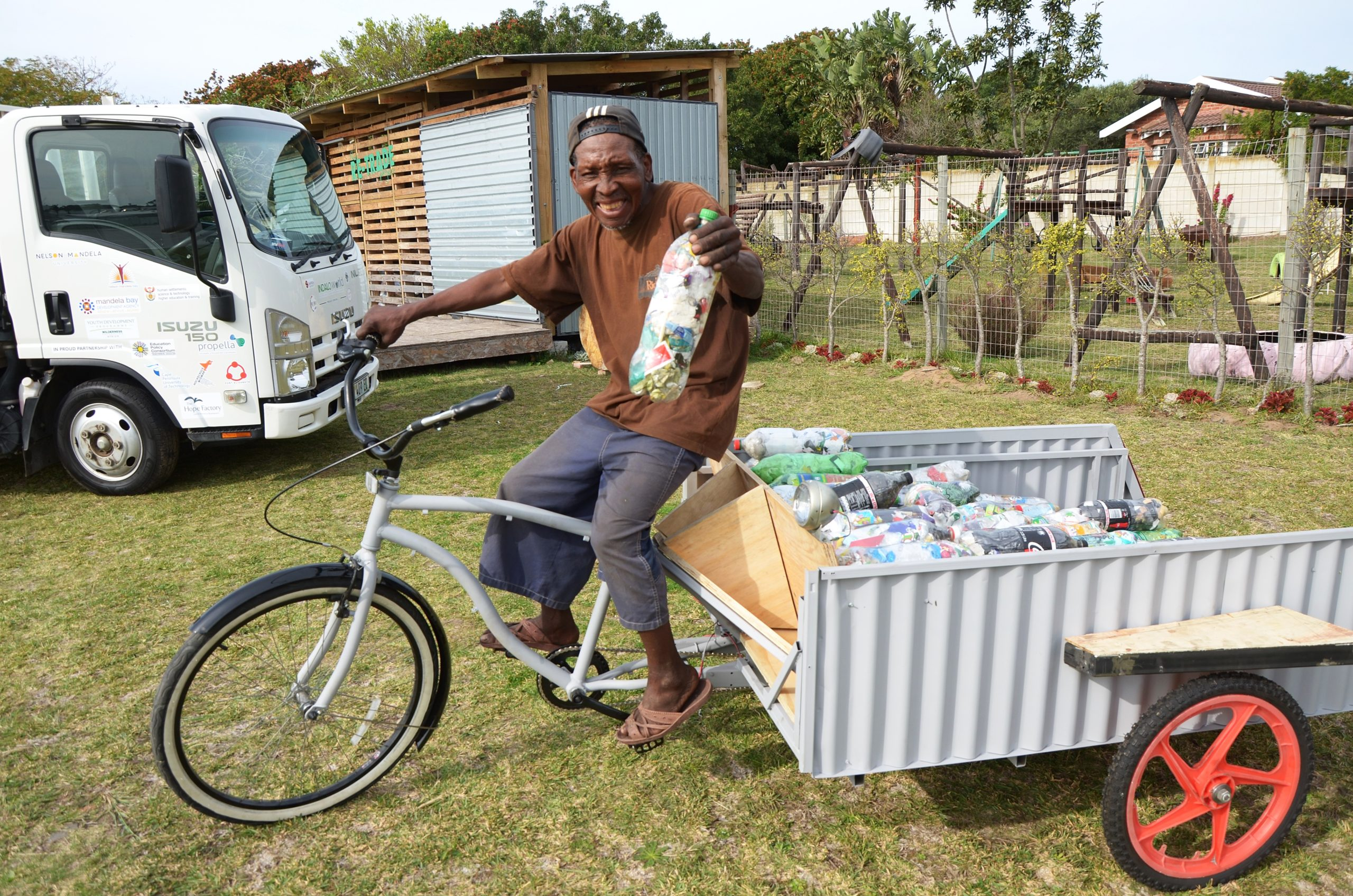 Khululekile 'Wilson' Moko tries out his new mode of transport which was built out of waste material donated by Isuzu Motors South Africa.