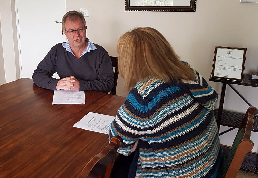 Malcolm Young, general manager of Riverview Manor based in Underberg, councils a client.