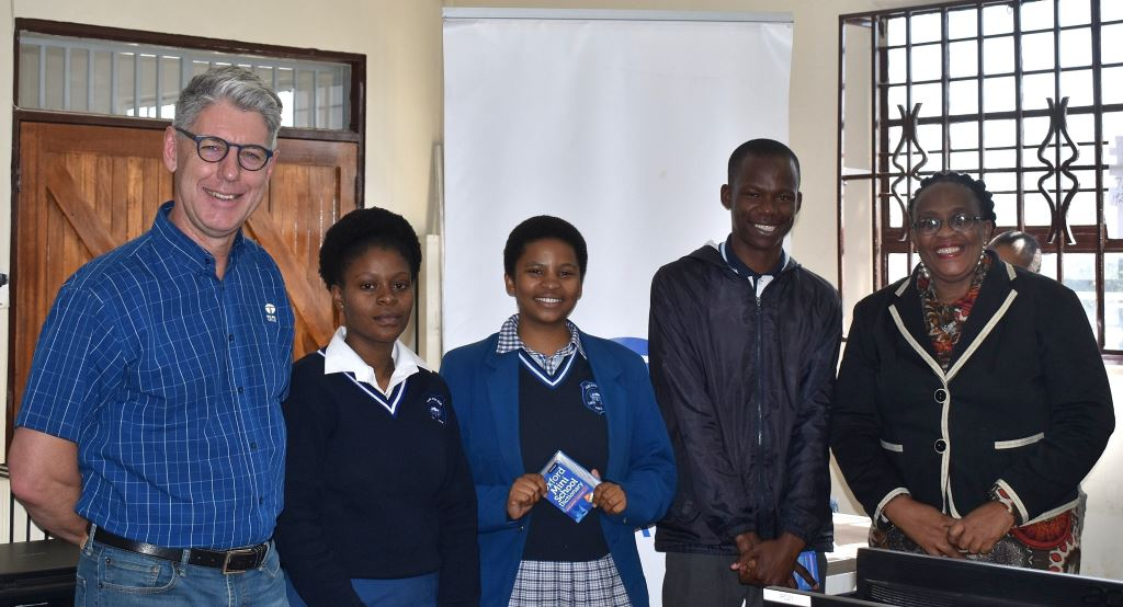 CEO of Tata Africa Holdings, Len Brand, with grade 12 learners and principal Mrs Zoleka Lebelo (right) of Alexander High School.