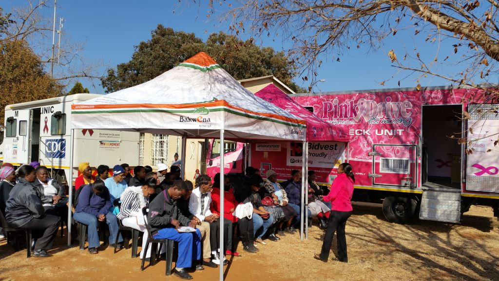 As part of Women's Month in August, Bakwena N1N4​ ​has​, ​for the seventh year, partnered​ ​with​ ​PinkDrive​ ​and​ ​the Department​ ​of​ ​Health​ ​to​ ​raise​ ​awareness​ ​around​ ​breast cancer as well as ​testicular​ ​and​ ​prostate​ ​cancer​ ​in communities​ ​adjacent​ ​to​ ​the​ ​Platinum​ ​Highway​ ​in​ ​North​ ​West​ ​Province. The​ fully equipped ​Pink​Drive​ ​mammography​ ​truck can be seen in the background.