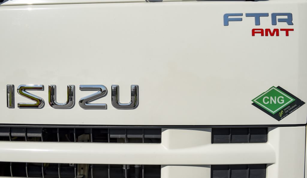 Note the CNG label on the front of this Isuzu N-Series (NPR300) truck. It uses Compressed Natural Gas (CNG) as well as a Stop-Start fuel saving system to create a more environmentally friendly truck while reducing operating costs.