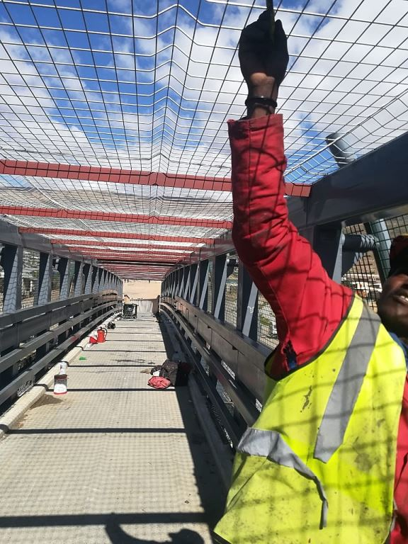 The pedestrian bridge over the N1 at De Doorns from which the boulder was thrown which resulted in the death of truck driver Christopher Kgomo has been fully encaged by SANRAL so as to prevent any similar incidents occurring.