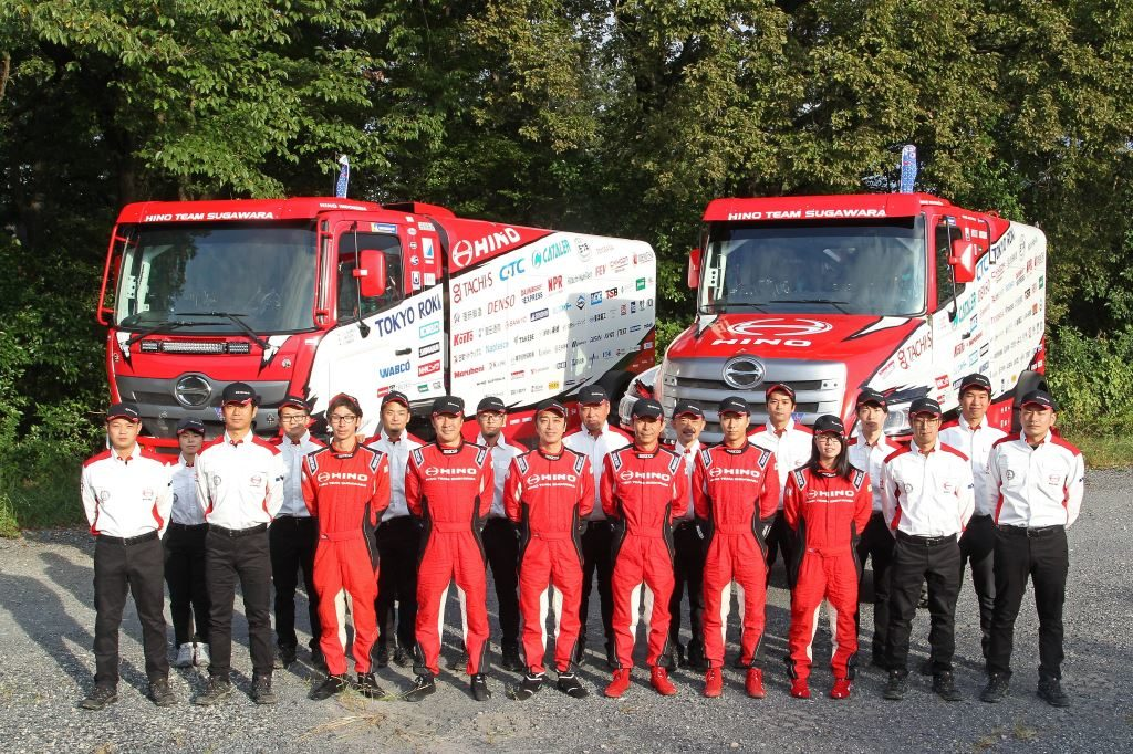 The Hino team and their trucks ready to take on the 2020 Dakar Rally. Both trucks will have three-man crews this year, after having had two-man crews for the past several Dakar Rallies. Each crew consists of a driver, navigator, and mechanic. The team has also increased the number of technicians and support crew.