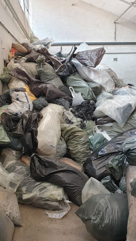 Watch the video: This is a room piled with purged plastic which has to be discarded due to power outages at a factory in Zimbabwe. Money down the drain.