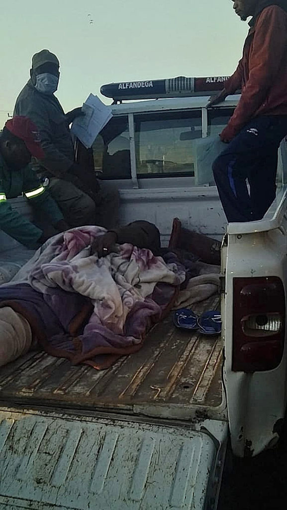 These two pictures epitomise the indignity and inhumane conditions truck drivers have had to put up with due to the delays taken in clearing trucks into South Africa at the Lebombo border post. A Reinhardt Transport truck driver was standing next to his truck talking to some friends when he was knocked over by a Mozambican truck which was jumping the queue. He was treated on to scene by his colleagues and was then transported by the Mozambique Customs guys on the back of a bakkie to a clinic for further treatment. The conditions these drivers have had to put up with are shocking.
