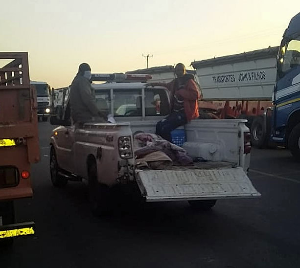 These two pictures epitomise the indignity and inhumane conditions truck drivers have had to put up with due to the delays taken in clearing trucks into South Africa at the Lebombo border post. A Reinhardt Transport truck driver was standing next to his truck talking to some friends when he was knocked over by a Mozambican truck which was jumping the queue. He was treated on the scene by his colleagues and was then transported by the Mozambique Customs guys on the back of a bakkie to a clinic for further treatment. The conditions these drivers have had to put up with are shocking.