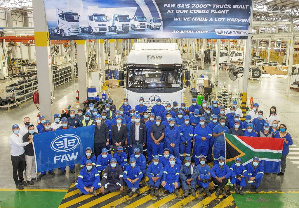 Staff and management at FAW Trucks gather to celebrate the 7 000th locally assembled FAW truck to roll out of its Coega manufacturing plant. The unit is the largest of the truck tractors from FAW Trucks, the JH6 28.500FT.