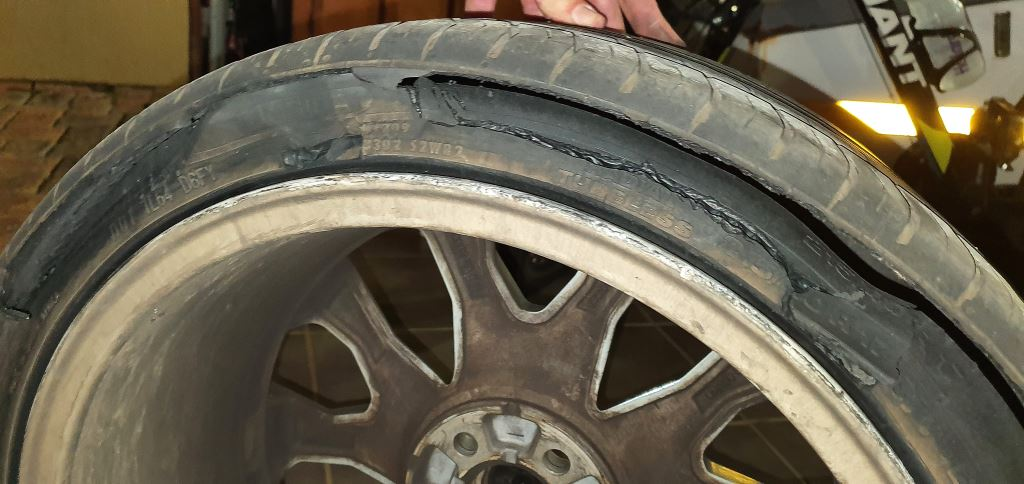 My son's car tyre – destroyed after hitting a pothole.