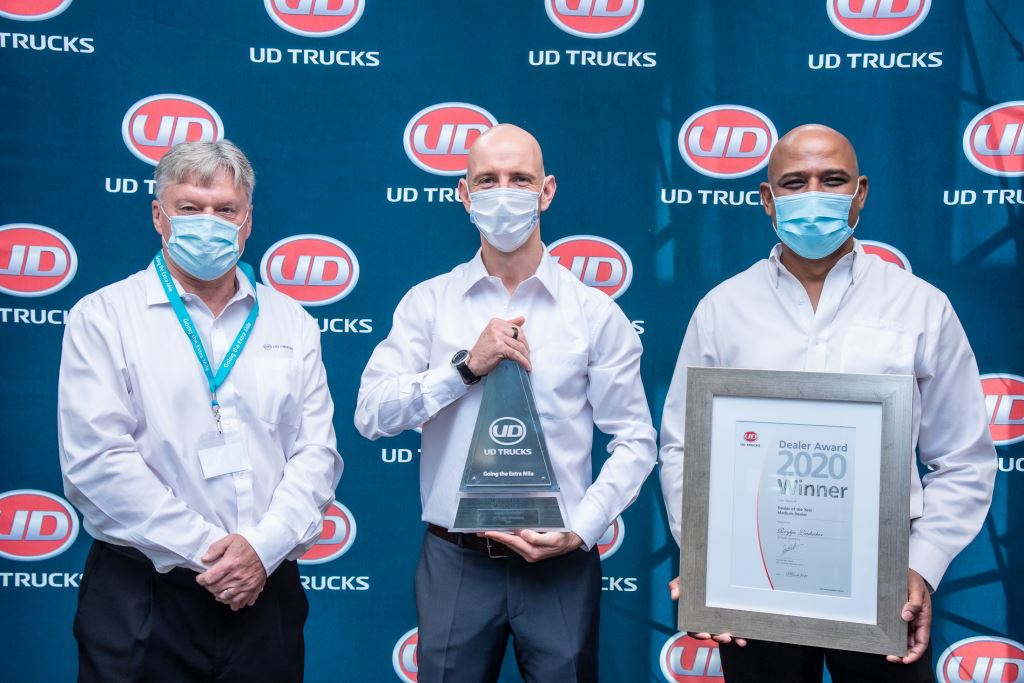 UD Trucks Lichtenburg took top honours as Medium Dealer of the Year. Here dealer principal, Reitjie Laubscher (centre), proudly receives his award from Rory Schulz (left), UD Trucks Southern Africa's Sales Director and Sanjay Naipal, Aftermarket Director.