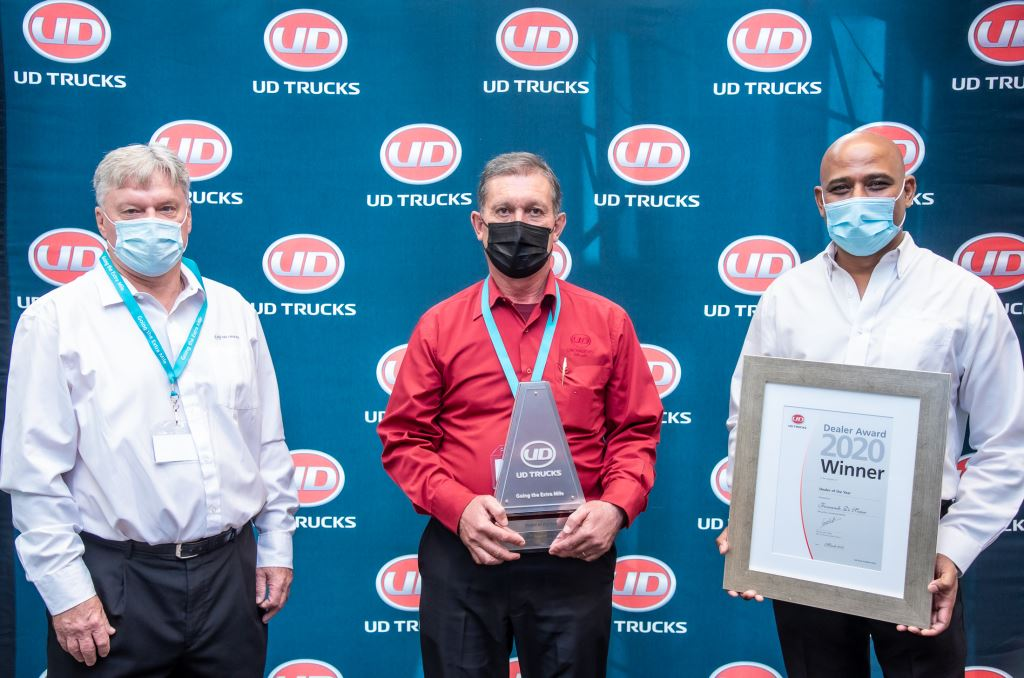 Fernando de Sousa (centre), dealer principal of McCarthy Commercial Vehicles Alrode, receives the award for large Dealer of the Year from Rory Schulz (left), UD Trucks Southern Africa's Sales Director and Sanjay Naipal, Aftermarket Director.