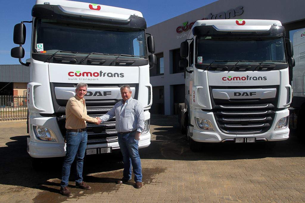 Mark Gavin, sales director Transport Solutions at Babcock (left), hands over the first two DAF XF units of a total 100 order to Bertus Kritzinger, director of the Cumotrans group.