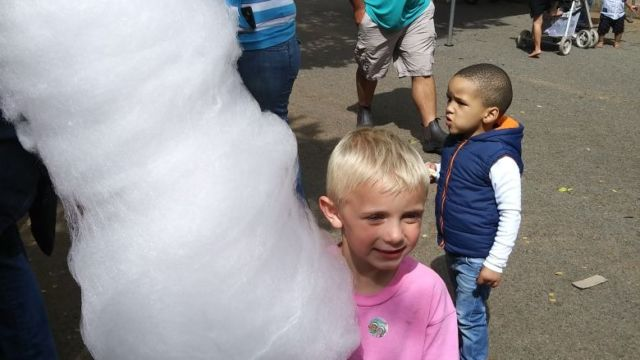 Young Markus thrilled at the size of his candy-floss. However, he is about to get a bigger surprise as dad arrives at a school sports function. That's James in the green shirt in the back-ground.