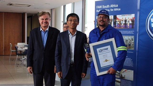 Seen at the recent Awards Ceremony held in February 2018 were (from left to right) Mr. Richard H. Leiter (left), Executive Director of FAW SA, Mr Martin Fick (right) receiving the FAW Top Technician Award from Mr. Jianyu Hao (middle), CEO of FAW SA.